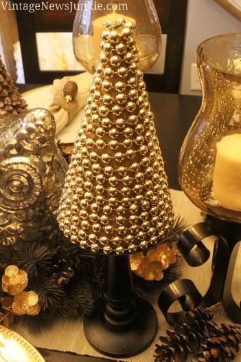 Gold bead pedestal accent